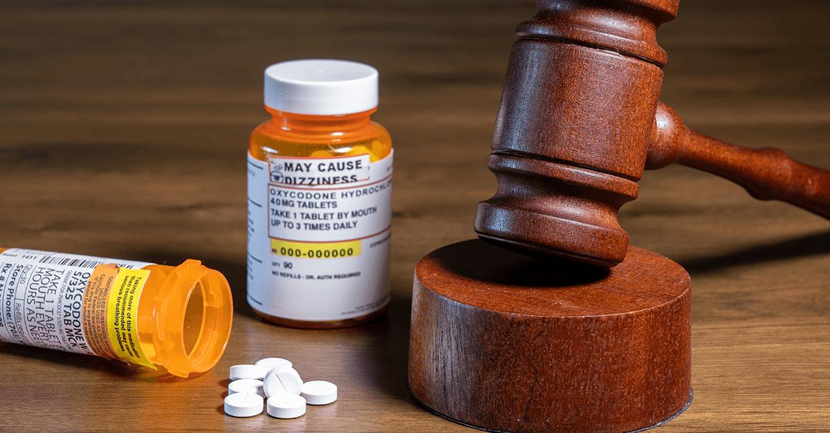 orange prescription bottles and gavel